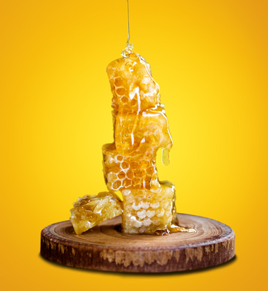 honey-and-Honey-wax-on-the-wood-with-yellow-background-banner-image-used-in-ernest24.com-site